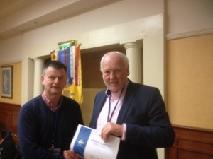 Tom receiving his prize from Manus Tiernan